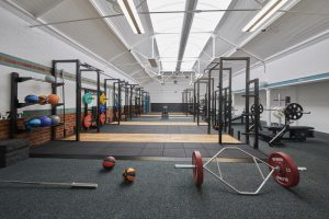 The free weights room in Tiverton Gym which contains six lifting platforms, benches and free weights.
