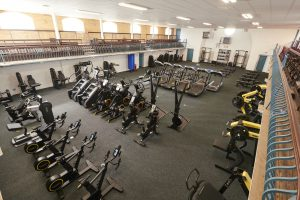 Tiverton gym main room with cardio machines including exercise bikes, stair climbers and treadmills.
